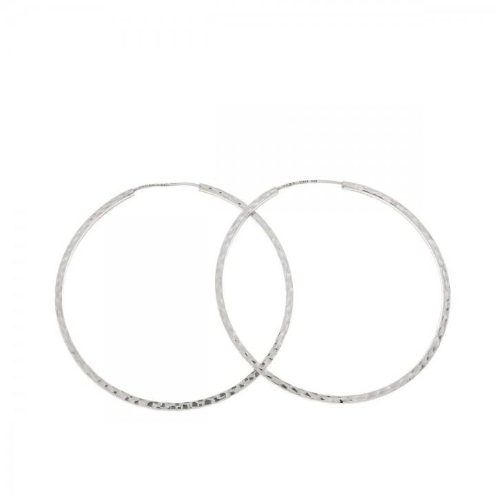 Серьги для женщины. Белое золото 14 карат,  диаметр - 4.5 см