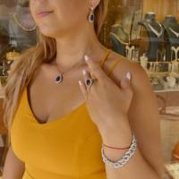 Набор для женщины с сапфирами - кулон, серьги, кольцо. Белое золото